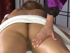 Horny masseuse engulfing clients pussy during massage session
